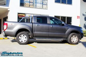 Right side view of a Ford PXII Ranger in Grey before fitment of a Super Pro Ezy Lift 45mm Lift Kit