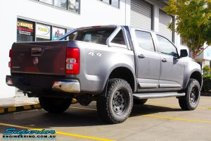"Rear right view of a Grey Holden RG Colorado Dual Cab after fitment of a Superior Nitro Gas 3"" Inch Lift Kit"