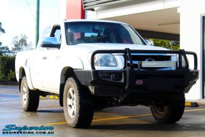 Right front side view of a White Mazda BT50 before fitment of a 35mm Lift Kit