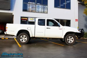 Right side view of a White Mazda BT50 before fitment of a 35mm Lift Kit