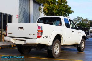 Rear right view of a White Mazda BT50 before fitment of a 35mm Lift Kit