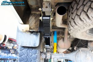 Rear underbody view of the left side fitted Bilstein Shocks + EFS Leaf Springs