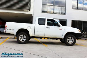 Right side view of a White Mazda BT50 after fitment of a 35mm Lift Kit
