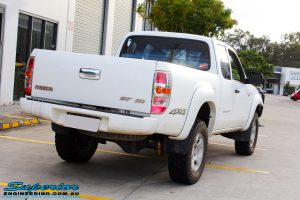 Rear right view of a White Mazda BT50 after fitment of a 35mm Lift Kit