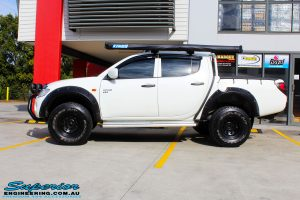 "Left side view of a Mitsubishi ML Triton in White after fitment of a Superior Nitro Gas 2"" Inch Lift Kit"