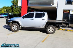 Left side view of a Mitsubishi MN Triton in Silver On The Hoist @ Superior being fitted with a Chassis Brace/Repair Plate