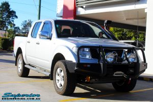 Right front side view of a Silver Nissan D40 Navara being fitted with a Brown Davis Long Range Fuel Tank @ Superior