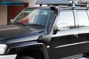 Right side close up shot of a Black Nissan GU Patrol Wagon after being fitted with a Safari Snorkel