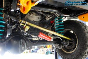 Front underbody shot of the fitted Superior Tie Rod Comp Spec 4340m Solid Bar