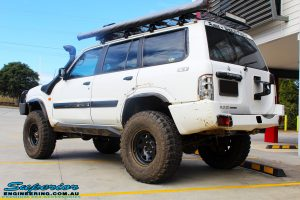 Rear left view of a White Nissan GU Patrol Wagon after being fitted with Superior Hybrid 5 Link Radius Arms, 55mm Shock Tower Lift Kit & Bump Stop Extensions