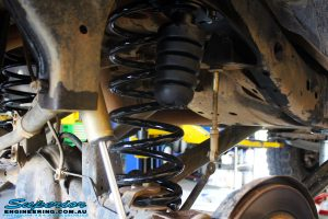 Left rear inside close up shot of the fitted Bump Stop Extensions with Coil Springs