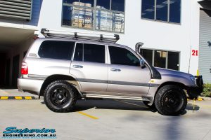 """Right side view of a Silver Toyota 100 Series Landcruiser before fitment of a 2"""" Inch Lift Kit with Airbags"""