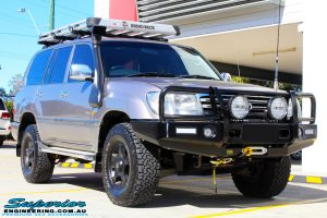 """Right front side view of a Silver Toyota 100 Series Landcruiser after fitment of a 2"""" Inch Lift Kit with Airbags"""