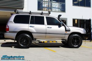 "Right side view of a Silver Toyota 100 Series Landcruiser after fitment of a 2"" Inch Lift Kit with Airbags"