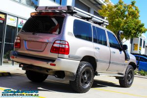"Rear right view of a Silver Toyota 100 Series Landcruiser after fitment of a 2"" Inch Lift Kit with Airbags"