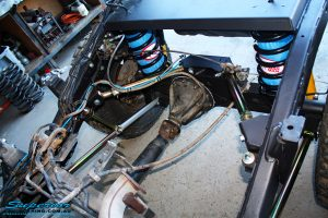 Mid top view of the fitted rear coil conversion + airbag coil helper air kit.