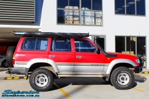 """Right side view of a Red Toyota 80 Series Landcruiser before fitment of a Fox 2.0 Performance Series IFP 2"""" Inch Lift Kit"""