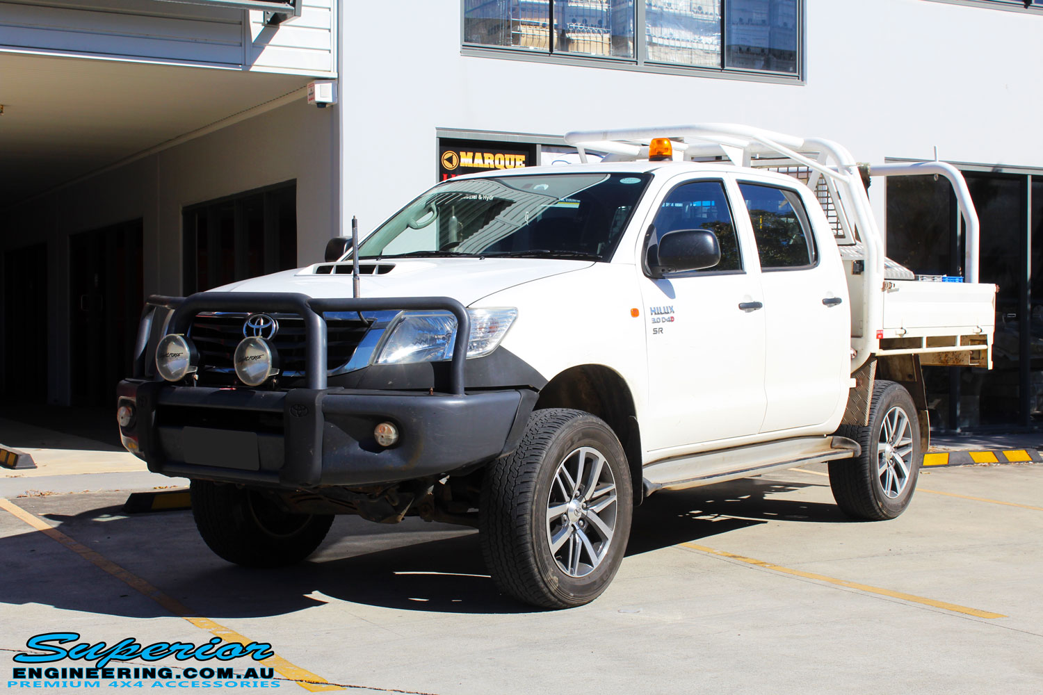 """Left front side view of a Toyota Vigo Hilux Dual Cab in White after fitment of a Superior Nitro Gas 2"""" Inch Lift Kit"""