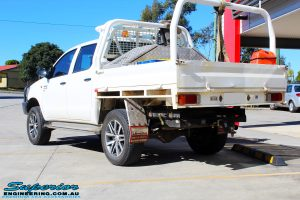"Rear left view of a Toyota Vigo Hilux Dual Cab in White after fitment of a Superior Nitro Gas 2"" Inch Lift Kit"