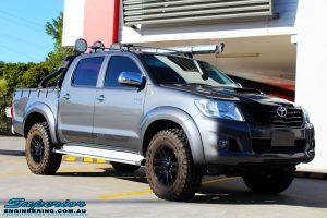 """Right front side view of a Grey Toyota Vigo Hilux Dual Cab before fitment of a 2"""" Inch Lift Kit, VRS Winch & Ironman 4x4 Bullbar"""