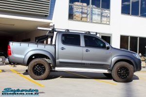 "Right side view of a Grey Toyota Vigo Hilux Dual Cab before fitment of a 2"" Inch Lift Kit, VRS Winch & Ironman 4x4 Bullbar"