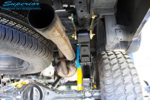 """Right rear underbody view of the fitted Bilstein 2"""" Inch Rear Shock + Leaf Spring"""
