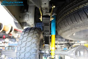 "Left rear underbody view of the fitted Bilstein 2"" Inch Rear Shock + Leaf Spring"