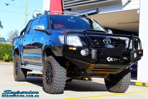 """Right front side view of a Grey Toyota Vigo Hilux Dual Cab after fitment of a 2"""" Inch Lift Kit, VRS Winch & Ironman 4x4 Bullbar"""