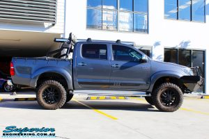 """Right side view of a Grey Toyota Vigo Hilux Dual Cab after fitment of a 2"""" Inch Lift Kit, VRS Winch & Ironman 4x4 Bullbar"""