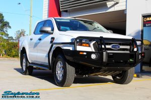 Right front side view of a White Ford PXII Ranger Dual Cab fitted with a Ironman 4x4 Commercial Bull Bar & Steel Side Steps