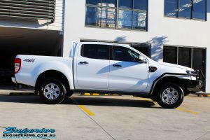 Right side view of a White Ford PXII Ranger Dual Cab fitted with a Ironman 4x4 Commercial Bull Bar & Steel Side Steps