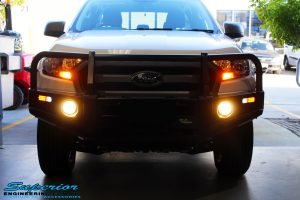 Front on shot of the fitted Ironman 4x4 Commercial Bull Bar with Illuminated Fog Lights