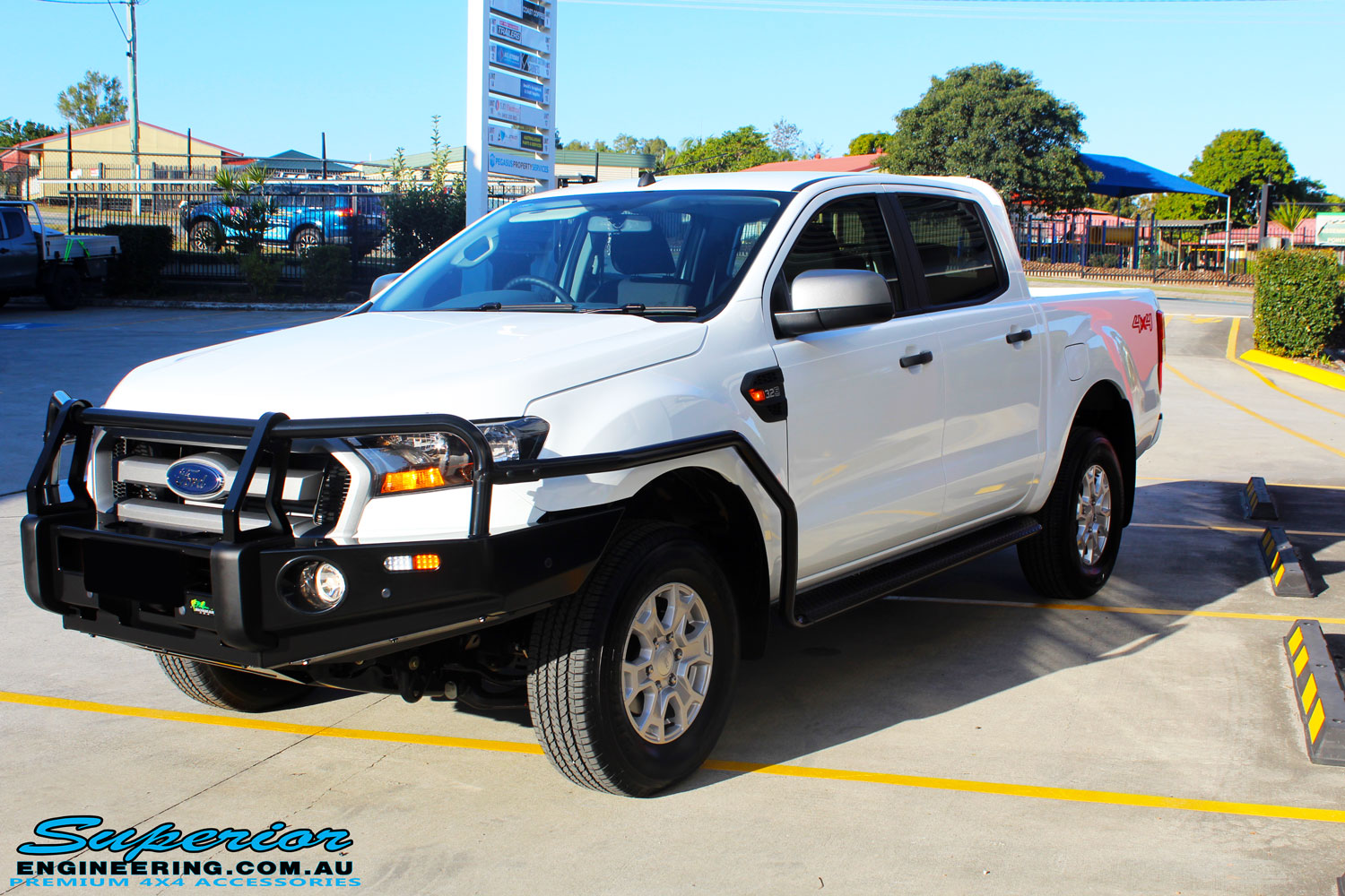 Right left side view of a White Ford PXII Ranger Dual Cab fitted with a Ironman 4x4 Commercial Bull Bar & Steel Side Steps