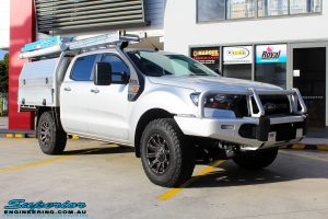 """Right front side view of a Ford PXII Ranger in Silver before fitment of a Superior 2"""" Inch Remote Reservoir Lift Kit"""