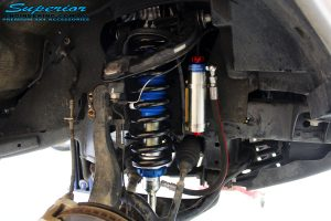 Front left inside guard view of the fitted Remote Reservoir Front Strut + Coil Springs