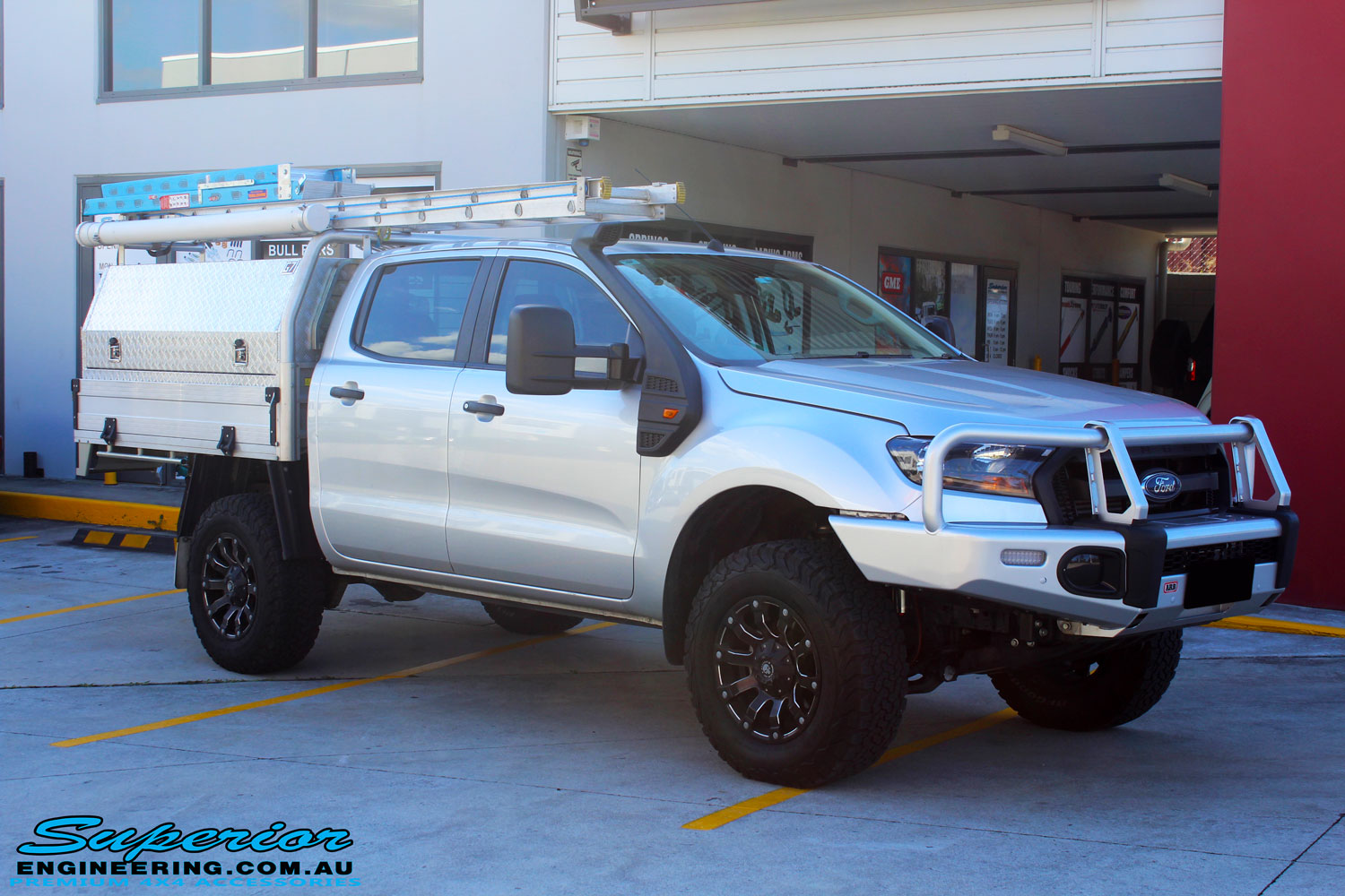 "Right front side view of a Ford PXII Ranger in Silver after fitment of a Superior 2"" Inch Remote Reservoir Lift Kit"