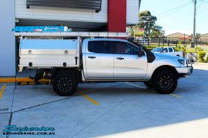 "Right side view of a Ford PXII Ranger in Silver after fitment of a Superior 2"" Inch Remote Reservoir Lift Kit"