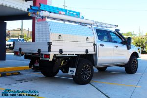 """Rear right view of a Ford PXII Ranger in Silver after fitment of a Superior 2"""" Inch Remote Reservoir Lift Kit"""