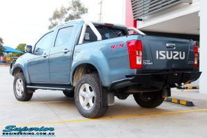 Rear left side view of a Isuzu D-Max Dual Cab fitted with a Ironman 4x4 Commercial Black Bull Bar, Side Steps, Rear Towbar & VRS Winch