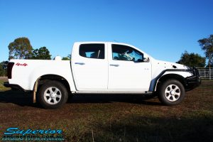"""Right side view of a White Isuzu D-Max Dual Cab being fitted with a Superior Remote Reservoir 2"""" Inch Lift Kit, Airbag Man Leaf Air Kit, Ironman 4x4 Bullbar + Side Steps, VRS Winch, Safari Snorkel + King Wheels & Nitto Tyres"""