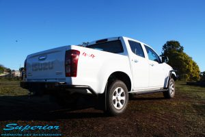 """Rear right view of a White Isuzu D-Max Dual Cab being fitted with a Superior Remote Reservoir 2"""" Inch Lift Kit, Airbag Man Leaf Air Kit, Ironman 4x4 Bullbar + Side Steps, VRS Winch, Safari Snorkel + King Wheels & Nitto Tyres"""
