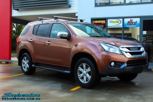 Right front side view of a Gold Isuzu MU-X Wagon before fitment of a Ironman 4x4 Roof Rack & Black Deluxe Bull Bar