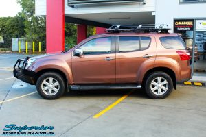 Left side view of a Gold Isuzu MU-X Wagon after fitment of a Ironman 4x4 Roof Rack & Black Deluxe Bull Bar