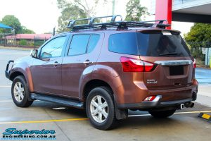 Rear left view of a Gold Isuzu MU-X Wagon after fitment of a Ironman 4x4 Roof Rack & Black Deluxe Bull Bar