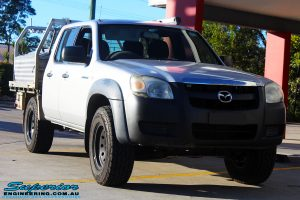 Right front side view of a Silver Mazda BT50 Dual Cab before fitment of a 35mm Lift Kit