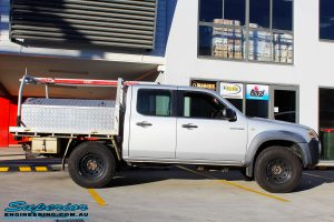 Right side view of a Silver Mazda BT50 Dual Cab before fitment of a 35mm Lift Kit