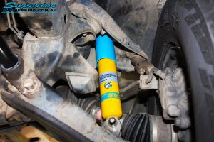 """Front left inside shot of the fitted 2"""" Inch Front Bilstein Shock"""