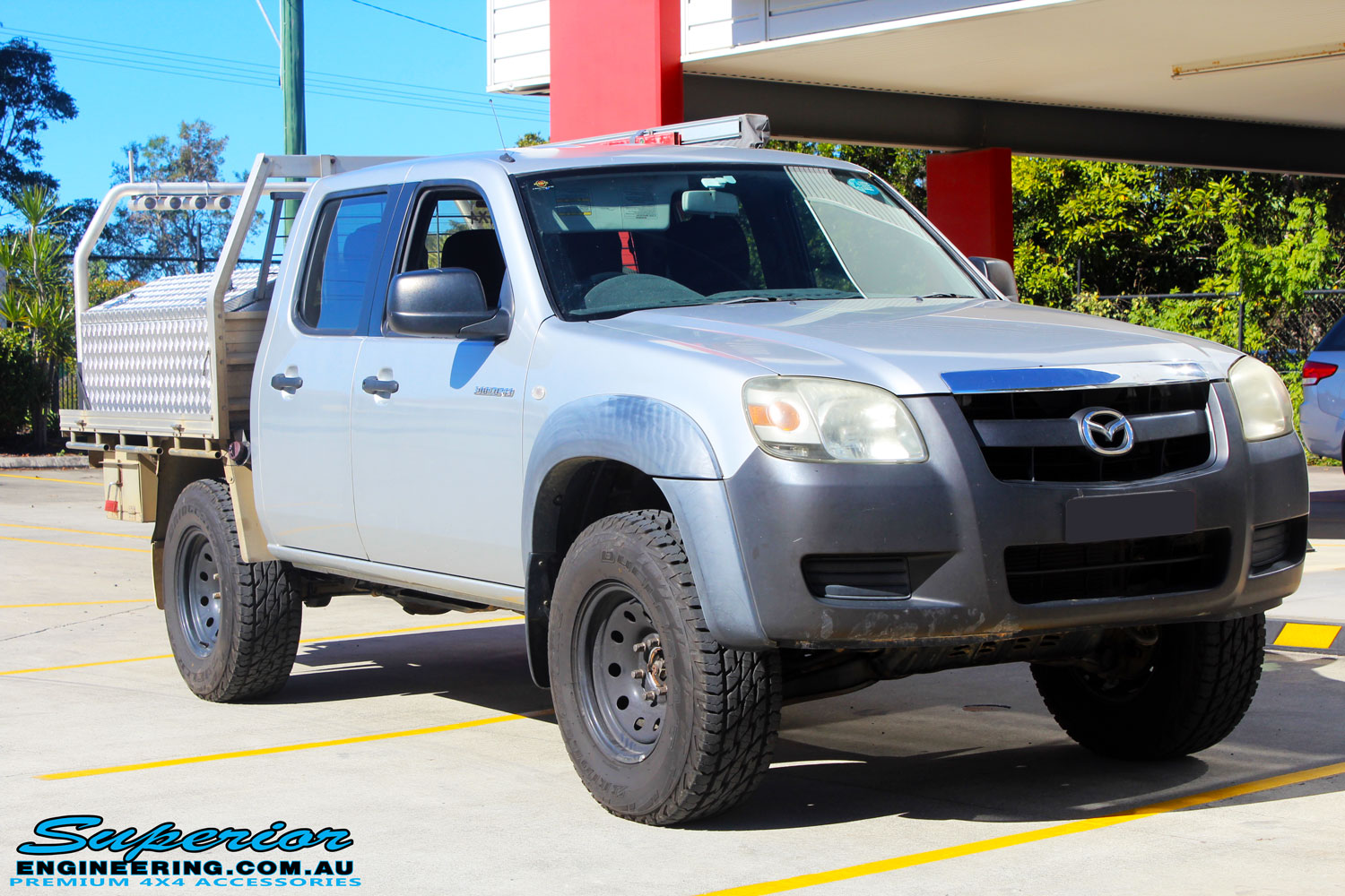 Right front side view of a Silver Mazda BT50 Dual Cab after fitment of a 35mm Lift Kit