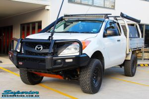 Left front side view of a White Mazda BT50 Freestyle Cab before fitment of a range of quality parts and accessories from Superior Engineering