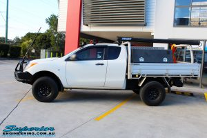 Side left view of a White Mazda BT50 Freestyle Cab before fitment of a range of quality parts and accessories from Superior Engineering
